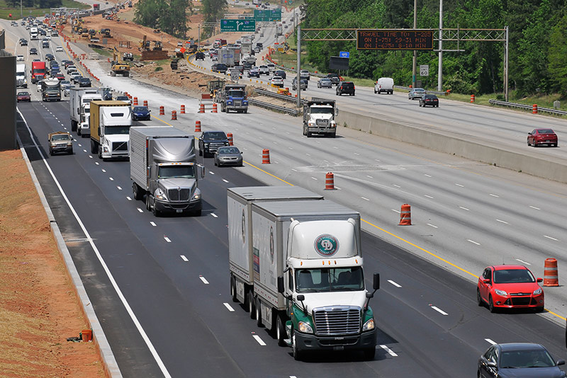 Trucks drive on I-75 southbound in Georgia as crews work on building center express lanes.
