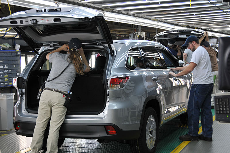 Toyota team members conduct the final inspection of a 2014 Highlander on the line