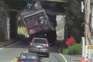 Truck Gets Destroyed By a Bridge