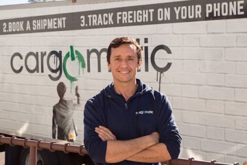 Cargomatic CEO Jonathan Kessler Stands in Front of a Branded Truck