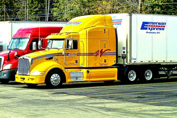 Emerson Express Yellow Semi Truck and Red Van