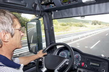 Truck Driver in the Cab of Semi Truck