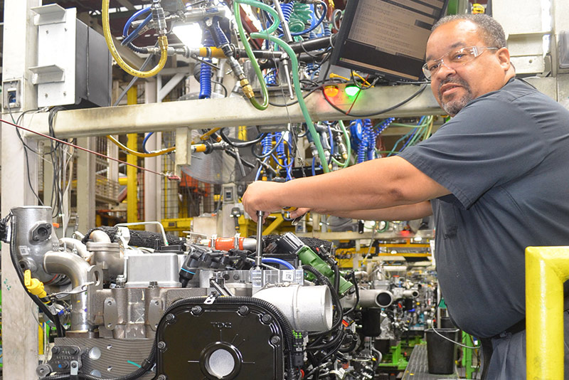 Workers build the Cummins Westport ISL G engine at the Cummins Rocky Mount Engine Plant in Whitakers, NC.