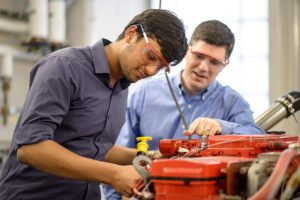 Purdue students work on cummins engines
