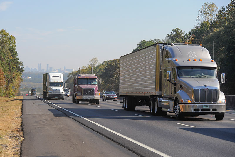Heavy duty trucks and truck drivers on the highway