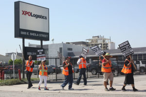 Truck drivers launched a strike against XPO Logistics at three Southern California locations to pressure shipping companies over independent contractor status.