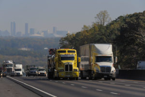 White and yellow truck on the freeway