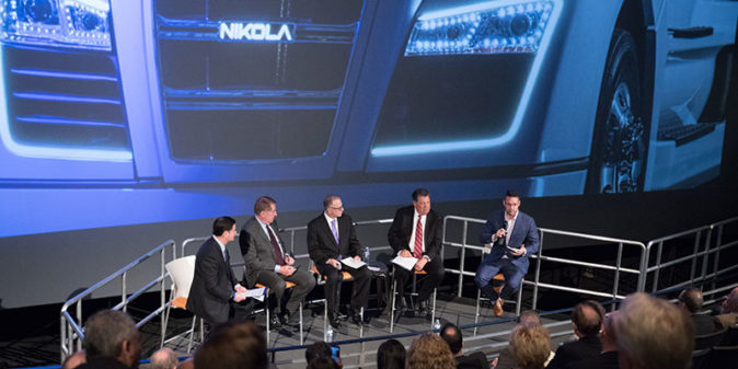 Nikola Motor Chief Executive Trevor Milton (right) fields questions at event announcing company's relocation to Arizona.