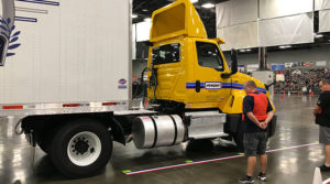 Judges inspect a truck at the 2018 National Truck Driving Championships.