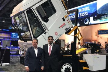 Michael Simon, chief executive of TransPower, left, and Chris Villavarayan, president of global trucks for Meritor Inc., with one of the port terminal trucks the companies will build for the ports of Long Beach and Oakland, Calif.